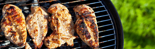 Grilled chicken breast on barbeque Stock Image