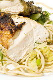 Grilled Chicken Breast on a Bed of Sphagetti Stock Image