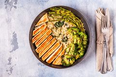 Grilled chicken breast with brown rice, spinach, broccoli, aspar royalty free stock photography