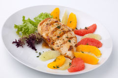 Grilled chicken breast and citrus salad Stock Images