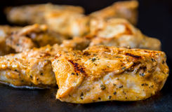 Grilled chicken breast. Close up of grilled seasoning delicious looking chicken breast on black silicone mat Stock Photo