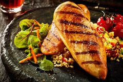 Grilled chicken breast with couscous Royalty Free Stock Photography