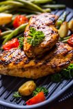 Grilled chicken breast in different variations with cherry tomat Stock Image