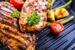 Grilled chicken breast in different variations with cherry tomat Royalty Free Stock Images