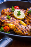 Grilled chicken breast in different variations with cherry tomat Royalty Free Stock Photo