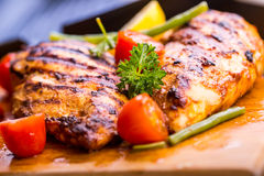 Grilled chicken breast in different variations with cherry tomat Stock Photo