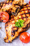 Grilled chicken breast in different variations with cherry tomatoes,  mushrooms, herbs, cut lemon on a wooden board or teflon pan. Stock Photography