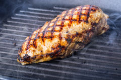 Grilled chicken breast in different variations with cherry tomatoes,  mushrooms, herbs, cut lemon on a wooden board or teflon pan. Royalty Free Stock Photo