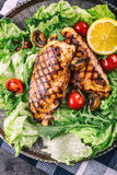 Grilled chicken breast in different variations with lettuce salad cherry tomatoes  mushrooms herbs cut lemon on a wooden board or Stock Photo