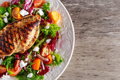 Grilled Chicken Breast fillet with fresh tomatoes vegetables salad. concept healthy food. Grilled Chicken Breast fillet with fresh tomatoes vegetables salad Stock Images