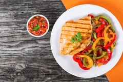 Grilled Chicken breast fillet and fried bell pepper , top view Stock Images