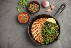 Grilled chicken breast fillet and green beans royalty free stock photography