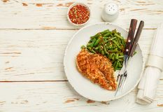 Grilled chicken breast fillet and green beans stock image