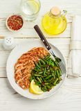 Grilled chicken breast fillet and green beans with spices royalty free stock images