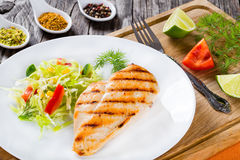 Grilled chicken breast fillet with low calories spring cabbage s. Healthy grilled chicken breast fillet with low calories spring cabbage salad with bell pepper Stock Image