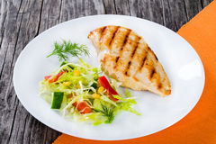 Grilled chicken breast fillet with low calories spring cabbage s Royalty Free Stock Image