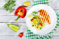 Grilled chicken breast fillet with vegetables salad, top view Royalty Free Stock Image