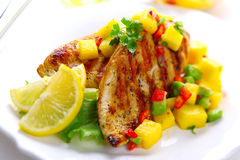 Grilled chicken breast with fresh mango salsa Stock Image
