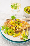 Grilled chicken breast with fresh mango salsa Royalty Free Stock Images