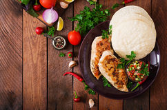 Grilled chicken breast with fresh tomato salsa and pita. royalty free stock photo