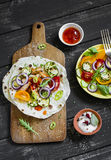 Grilled chicken breast, fresh vegetables - tomatoes, cucumbers, zucchini, onions, peppers and homemade tortilla Royalty Free Stock Image