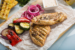 Grilled chicken breast with fries and salad Stock Photos