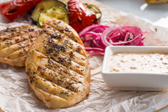 Grilled chicken breast with fries and salad Royalty Free Stock Images