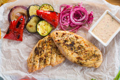Grilled chicken breast with fries and salad Royalty Free Stock Photography