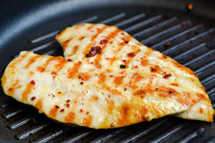 Grilled chicken breast. In frypan Stock Photo