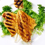 Grilled chicken breast with grilled garlic Stock Photography