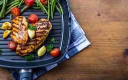 Free Grilled Chicken Breast In Different Variations With Cherry Tomat Stock Photography - 60747402