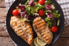 Grilled chicken breast with mixed salad close-up. horizontal top Stock Images