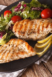Grilled chicken breast with mixed salad close-up. Vertical Royalty Free Stock Photography