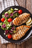 Grilled chicken breast with mixed salad close-up. Vertical top v Royalty Free Stock Photo