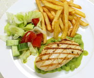 Grilled chicken breast on pea puree Stock Images