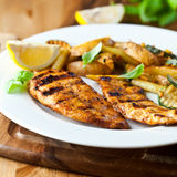 Grilled chicken breast with potatoes Stock Image