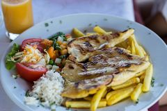 Grilled chicken breast with potatoes royalty free stock photography