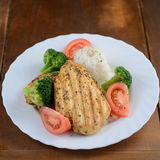 Grilled chicken breast with rice and vegetables Royalty Free Stock Images