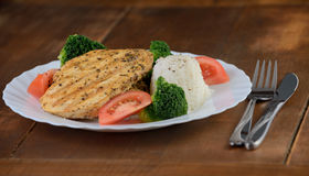 Grilled chicken breast with rice and vegetables Royalty Free Stock Image