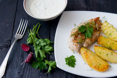 Grilled chicken breast with roasted potatoes Stock Image