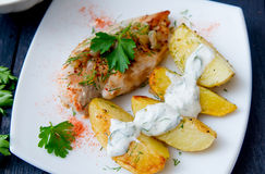 Grilled chicken breast with roasted potatoes Stock Photography