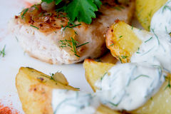 Grilled chicken breast with roasted potatoes Stock Photos