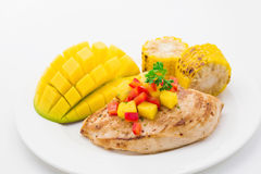 Grilled chicken breast with salsa and vegetables Stock Photo