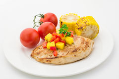 Grilled chicken breast with salsa and vegetables Royalty Free Stock Image