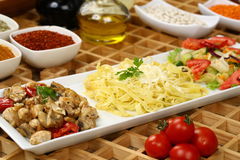Grilled Chicken Breast with sauce and pasta stock images