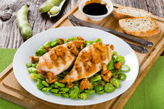 Grilled chicken breast served with fried butter beans and chante Royalty Free Stock Image