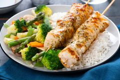 Chicken skewers with steamed vegetables and long rice Stock Images