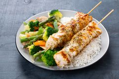 Chicken skewers with steamed vegetables and long rice Stock Photography