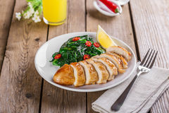 Grilled chicken breast with spinach Stock Images