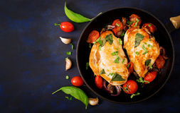 Grilled Chicken breast stuffed with tomatoes, garlic and basil in pan. Top view royalty free stock photos